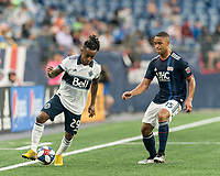 FOXBOROUGH, MA - JULY 17: Yordy Reyna #29 controls the ball as Brandon Bye #15 defends during a game between Vancouver Whitecaps and New England Revolution at Gillette Stadium on July 17, 2019 in Foxborough, Massachusetts.