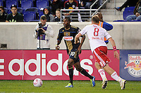 Danny Mwanga (10) of the Philadelphia Union is marked by Jan Gunnar Solli (8) of the New York Red Bulls. The New York Red Bulls defeated the Philadelphia Union  1-0 during a Major League Soccer (MLS) match at Red Bull Arena in Harrison, NJ, on October 20, 2011.