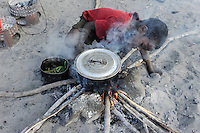 "Afrika SAMBIA Barotseland Mongu, Lozi Dorf Ilundu, Junge an Feuerstelle | .Africa ZAMBIA Barotseland village of Lozi Ethic group, boy at fire place .| [ copyright (c) Joerg Boethling / agenda , Veroeffentlichung nur gegen Honorar und Belegexemplar an / publication only with royalties and copy to:  agenda PG   Rothestr. 66   Germany D-22765 Hamburg   ph. ++49 40 391 907 14   e-mail: boethling@agenda-fototext.de   www.agenda-fototext.de   Bank: Hamburger Sparkasse  BLZ 200 505 50  Kto. 1281 120 178   IBAN: DE96 2005 0550 1281 1201 78   BIC: ""HASPDEHH"" ,  WEITERE MOTIVE ZU DIESEM THEMA SIND VORHANDEN!! MORE PICTURES ON THIS SUBJECT AVAILABLE!! ] [#0,26,121#]"