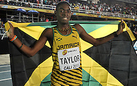 CALI - COLOMBIA - 17-07-2015: Christopher Taylor de Jamaica, celebra después de ganar la prueba de los 400 metros en el estadio Pascual Guerrero sede, sede de IAAF Campeonatos Mundiales de la Juventud Cali 2015.  / Christopher Taylor of Jamaica, celebrates after winning the test of 400 meters in the Pascual Guerrero home of the IAAF World Youth Championships Cali 2015. Photos: VizzorImage / Luis Ramirez / Staff.