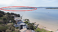BNPS.co.uk (01202) 558833. <br /> Pic: CorinMesser/BNPS<br /> <br /> Pictured: The development site at Dorset Lake Avenue in Poole, Dorset opens onto Poole Harbour by the Sandbanks Peninsula (circled). <br /> <br /> A wealthy homeowner has made the 'brave' decision to demolish his £6m seaside mansion that has its own indoor pool, gym and cinema. <br /> <br /> Ashley Faull has flattened the 20-year-old luxury house to build nine new flats to meet the increasing demand for housing that has led to a surge in property prices.<br /> <br /> The apartments will be priced between £1.495m to £2.8m.<br /> <br /> The now ruined four-storey and 19-room home sits on a half-an-acre plot that backs on to Poole Harbour and overlooks exclusive Sandbanks in Dorset.