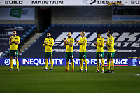 2nd February 2021; The Den, Bermondsey, London, England; English Championship Football, Millwall Football Club versus Norwich City; Norwich City players applauding in tribute to Captain Sir Tom Moore who passed away today at the age of 100