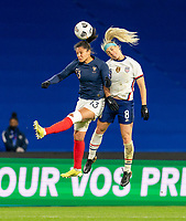 LE HAVRE, FRANCE - APRIL 13: Valerie Gauvin #13 of France goes up for a header with Julie Ertz #8 of the USWNT during a game between France and USWNT at Stade Oceane on April 13, 2021 in Le Havre, France.