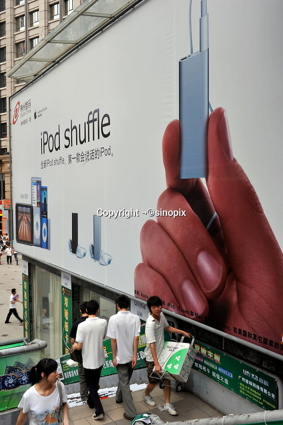 An advertisement for ipod shuffle in Guangzhou, China. The financial crisis won't have too much impact on Chinese consuming market. According to a survey by Nielsen of 50 countries and regions, only 35 percent of Chinese people believed the domestic economy was in a contraction. The figure was the lowest among the 50 world markets..