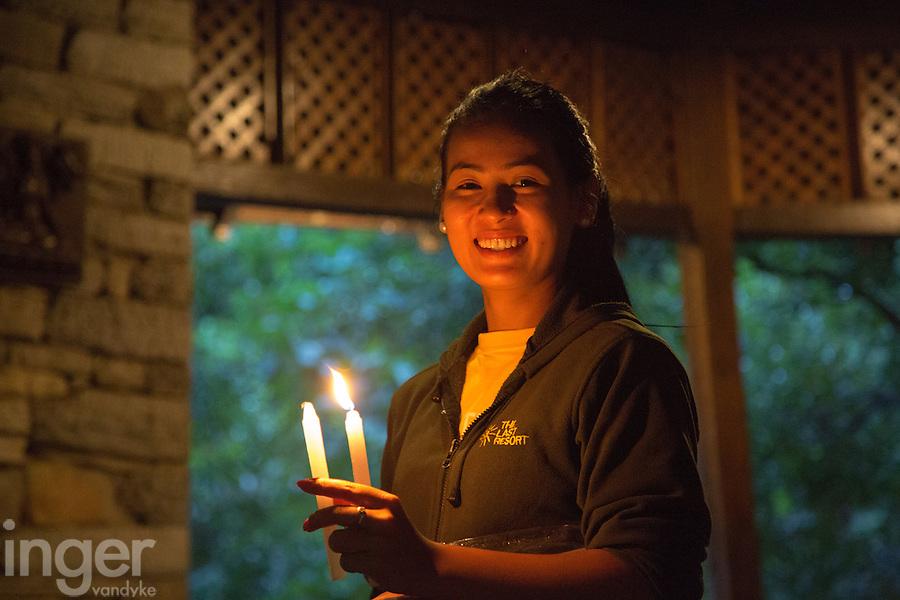 Waitress Lighting Candles at The Last Resort, Nepal