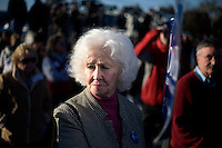 """Romney supporter Barbara Clark, of Nashua, NH, waits for Republican presidential candidate Mitt Romney, former governor of Massachusetts, to at a rally in Manchester, New Hampshire, on Sat. Dec. 3, 2011. The rally was called, """"Earn It with Mitt,"""" and was designed to bolster local efforts to help Romney """"earn"""" voters' support for the upcoming Republican primary. Clark is a lifelong Republican, having voted for Republicans since Eisenhower.  """"The only Democrat I voted for Koch in New York,"""" said Clark."""