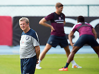 England manager Roy Hodgson and Steven Gerrard behind