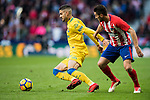 Hernan Dario Toledo (L) of UD Las Palmas fights for the ball with Jorge Resurreccion Merodio, Koke, of Atletico de Madrid during the La Liga 2017-18 match between Atletico de Madrid and UD Las Palmas at Wanda Metropolitano on January 28 2018 in Madrid, Spain. Photo by Diego Souto / Power Sport Images