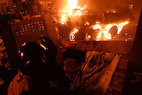 An APC that advanced under the protesters' barricades has been burnt by a haling of petrol bombs.  Kiev, Ukraine