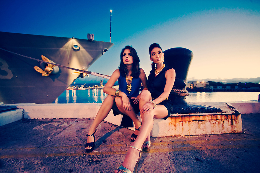 Two models sitting in front of the USS Port Royal for March Issue 2010 Military Spouse Magazine Fashion shoot