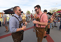DRESSED FOR OKTOBERFEST<br />Justin Post (left) and Garrett Collier, both of Rogers, sport traditional lederhosen on Saturday Oct. 9 2021 at the downtown Rogers Oktoberfest at Railyard Park. Several craft breweries served cold beer and the Rogers Downtown Rotary Club grilled brats. Bavarian music and costume contests took place on the Butterfield Stage. Go to nwaonline.com/211010Daily/ to see more photos.<br />(NWA Democrat-Gazette/Flip Putthoff)