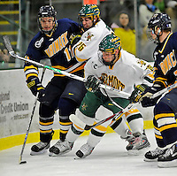 16 February 2008: University of Vermont Catamounts' forward Jay Anctil (16), a Sophomore from Wolfeboro, NH, and forward Jonathan Higgins (25), a Sophomore from Stratham, NH, struggle for puck control against Merrimack College Warriors' forward Matt Jones (11), a Sophomore from Kentwood, MI, at Gutterson Fieldhouse in Burlington, Vermont. The Catamounts defeated the Warriors 2-1 for their second win of the 2-game weekend series...Mandatory Photo Credit: Ed Wolfstein Photo