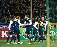 Krasnodar - Russia, Tuesday, November 13, 2012: The USMNT ties Russia 2-2 at Kuban Stadium. Mix Diskerud is congratulated on his goal.