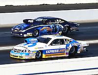 Nov 10, 2013; Pomona, CA, USA; NHRA pro stock driver Allen Johnson (near lane) races alongside Rodger Brogdon during the Auto Club Finals at Auto Club Raceway at Pomona. Mandatory Credit: Mark J. Rebilas-
