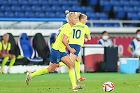 YOKOHAMA, JAPAN - AUGUST 6: Captain Caroline Seger #17 of Sweden controls the ball during a game between Canada and Sweden at International Stadium Yokohama on August 6, 2021 in Yokohama, Japan.