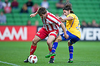MELBOURNE, AUSTRALIA - OCTOBER 23: Michael Marrone of the Heart protects the ball during the A-League match between the Melbourne Heart and Gold Coast United at AAMI Park on October 23, 2010 in Melbourne, Australia. (Photo by Sydney Low / Asterisk Images)