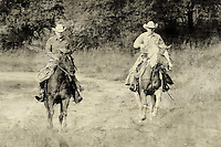 Two cowboys, aged look