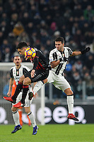 Calcio, quarti di finale di Tim Cup: Juventus vs Milan. Torino, Juventus Stadium, 25 gennaio 2017.<br /> AC Milan's Giacomo Bonaventura, left, and Juventus' Miralem Pjanic jump for the ball during the Italian Cup quarter finals football match between Juventus and AC Milan at Turin's Juventus stadium, 25 January 2017.<br /> UPDATE IMAGES PRESS/Manuela Viganti