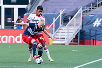 FOXBOROUGH, MA - JUNE 26: Connor Presley #7 of the New England Revolution holds off against Gibran Rayo #14 of North Texas during a game between North Texas SC and New England Revolution II at Gillette Stadium on June 26, 2021 in Foxborough, Massachusetts.