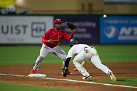 Palm Beach Cardinals third baseman Jordan Walker (37) waits for a pickoff throw before tagging J.D. Orr (12) out during a game against the Jupiter Hammerheads on May 11, 2021 at Roger Dean Stadium in Jupiter, Florida.  (Mike Janes/Four Seam Images)