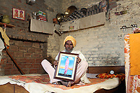 Ghukar Singh (58) holds a portrait of his late daughter, Amandeep Kaur,who died in 2013 from cancer, aged only 23. It is believed that excessive pesticide use in the region over the past 30-40 years has led to the accumulation of dangerous levels of toxins such as uranium, lead and mercury which are contributing to increased health problems including cancers, birth defects and mental disabilities in children. It's a hidden epidemic which is gripping the Punjab region in northeast India which for decades has been the country's 'bread basket'. As local farmers and their families continue to get ill they are paying the price for the country's 'Green Revolution'.