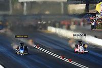 Oct. 15, 2011; Chandler, AZ, USA; NHRA top fuel dragster driver Cory McClenathan (left) races Shawn Langdon during qualifying for the Arizona Nationals at Firebird International Raceway. Mandatory Credit: Mark J. Rebilas-