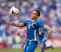 Rodolfo Zelaya (11) of El Salvador controls the ball during the quarterfinals of the CONCACAF Gold Cup at M&T Bank Stadium in Baltimore, MD.  The United States defeated El Salvador, 5-1.