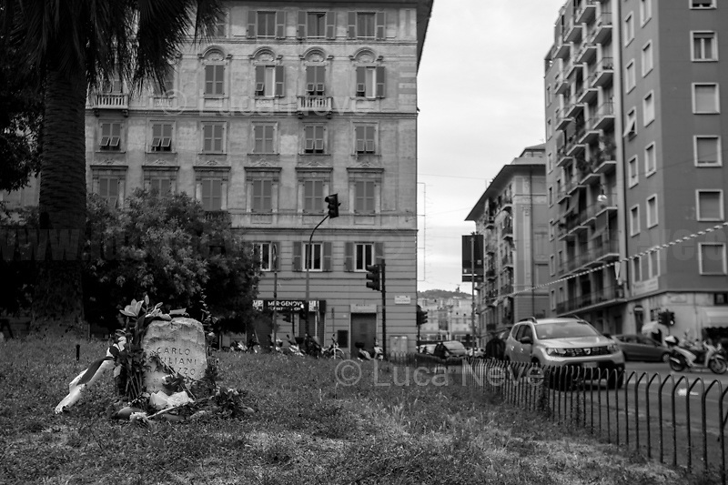 """Piazza Alimonda renamed as Piazza Carlo Giuliani, Ragazzo.<br /> <br /> Genoa, Italy. 19, 20, 21 July 2021. Twenty years after the dramatic and terrifying events related to the 2001 Genoa's G8 meeting, according to Amnesty International: """"the most serious suspension of democratic rights in a Western country since the Second World War"""" (1.) and as stated on the 2001 """"Report on the situation of fundamental rights in the EU"""" the European Parliament """"deplores the suspensions of fundamental rights that took place during public demos, and in particular at the G8 meeting in Genoa, such as freedom of expression, freedom of movement, the right to physical integrity"""" (2.). As a reminder, the City of Genoa is State Gold Medal (Medaglia D'Oro) for its Antifascist Resistance in World War II.<br /> Some photos, part of this story, are presented appositely in Black & White to show to the audience """"the Places"""" where the majority of - the already mentioned (see above) - """"suspensions of fundamental rights […] such as freedom of expression, freedom of movement, the right to physical integrity"""" (2.) happened.<br /> In these three days, throughout a series of events, Genoa and its People, survivors and witnesses, experts and activists, remembered what happened 20 years ago, discussed the present situation of a world dominated by """"casino capitalism"""", predatory neo-liberalism, wars, rightless globalization, ...<br /> <br /> FULL CAPTION AT THE BEGINNING OF THIS STORY.<br /> <br /> Footnotes, Links:<br /> 1. http://bit.do/fRvdg<br /> 2. http://bit.do/fRvdi<br /> 3. http://bit.do/fRvdj<br /> 4. http://bit.do/fRvdn<br /> 5. http://bit.do/fRvdo<br /> 6. http://bit.do/fRvdr<br /> 7. http://bit.do/fRvdt & http://bit.do/fRvdu<br /> 8. http://bit.do/fRvdv & http://bit.do/fRvdw & http://bit.do/fRvdx<br /> 9. http://bit.do/fRvdz<br /> 10. http://bit.do/fRvdA<br /> 11. http://bit.do/fRvdB<br /> http://www.veritagiustizia.it/doc_eng/<br /> https://www.carlogiuliani.it<br /> https://en.wikipedia.org/w"""