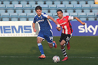 Randall Williams of Exeter City in possession as Gillingham's Robbie McKenzie looks on during Gillingham vs Exeter City, Emirates FA Cup Football at the MEMS Priestfield Stadium on 28th November 2020