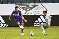 KANSAS CITY, KS - SEPTEMBER 23: Kyle Smith #24 of Orlando City with the ball during a game between Orlando City SC and Sporting Kansas City at Children's Mercy Park on September 23, 2020 in Kansas City, Kansas.