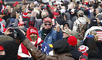 A supprter gestures towards the media as US President Donald J. Trump delivers remarks to supporters gathered to protest Congress' upcoming certification of Joe Biden as the next president on the Ellipse in Washington, DC, USA, 06 January 2021. Various groups of Trump supporters are gathering to protest as Congress prepares to meet and certify the results of the 2020 US Presidential election.<br /> Credit: Shawn Thew / Pool via CNP/AdMedia