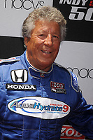 NEW YORK - MAY 25: Race car driver Mario Andretti attends Macy's and IZOD's celebration of the Indianapolis Motor Speedway and the Indy 500 at Macy's Herald Square on May 25, 2010 in New York City.<br /> <br /> <br /> People:  Mario Andretti
