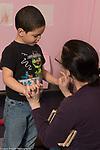 Education Preschool 4 year olds SEIT teacher talking seriously to boy
