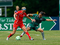 Washington Freedom midfielder Allie Long (9) and St. Louis Athletica defender Kendall Fletcher (24) during a WPS match at Anheuser-Busch Soccer Park, in Fenton, MO, June 20 2009. Washington  won the match 1-0.
