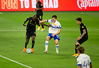 LOS ANGELES, CA - SEPTEMBER 02: Bradley Wright-Phillips #66 of LAFC attempts to move past Tanner Beason #15 of the San Jose Earthquakes during a game between San Jose Earthquakes and Los Angeles FC at Banc of California stadium on September 02, 2020 in Los Angeles, California.