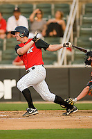 Jake Oester #22 of the Kannapolis Intimidators follows through on his swing against the Delmarva Shorebirds at Fieldcrest Cannon Stadium May 14, 2010, in Kannapolis, North Carolina.  Photo by Brian Westerholt / Four Seam Images