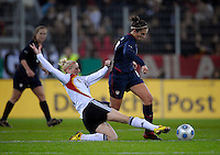 Anja Mittag slide tackles Carli Lloyd. US Women's National Team defeated Germany 1-0 at Impuls Arena in Augsburg, Germany on October 27, 2009.