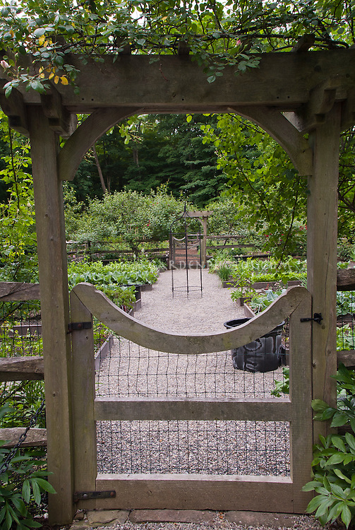 Raised Bed Vegetable & Herbs Garden Fenced Gate, stone pebble walkway, protection from pest animals, fruit trees at rear