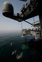 120323-N-DR144-621 ARABIAN SEA (March 23, 2012) Sailors swim to the stern dock after jumping off aircraft elevator No. 4 during a swim call aboard the Nimitz-class aircraft carrier USS Carl Vinson (CVN 70). Carl Vinson and Carrier Air Wing (CVW) 17 are deployed to the U.S. 5th Fleet area of responsibility.  (U.S. Navy photo by Mass Communication Specialist 2nd Class James R. Evans/Released)