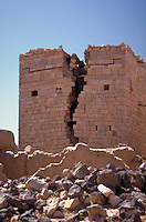 An old brick ruin that has cracked down the middle. Ma'rib, Yemen.