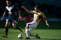 MELBOURNE, AUSTRALIA - DECEMBER 27: Adam D'Apuzzo of the Jets kicks the ball during the round 20 A-League match between the Melbourne Victory and the Newcastle Jets at AAMI Park on December 27, 2010 in Melbourne, Australia. (Photo by Sydney Low / Asterisk Images)
