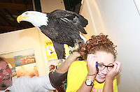 Aoife Jennings a volunteer at the Holiday World Show 2013 at the RDS meets Alaska the Bald-Headed Eagle..Collins Photos 25/1/13