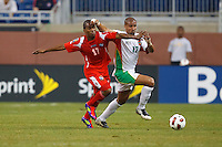 Panama defender Luis Henríquez (17) and Guadeloupe midfielder Cedric Collet (17) go for the ball during the CONCACAF soccer match between Panama and Guadeloupe at Ford Field Detroit, Michigan.