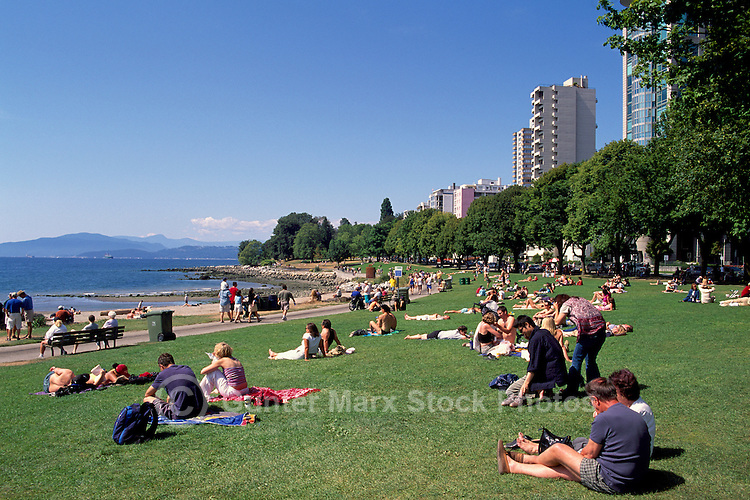 People sunbathing on Beach at English Bay, West End, Vancouver, BC, British Columbia, Canada, Summer