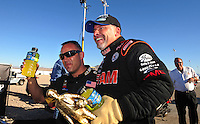 Apr. 13, 2008; Las Vegas, NV, USA: NHRA top fuel dragster driver Cory McClenathan (right) celebrates with teammate Tony Schumacher after winning the SummitRacing.com Nationals at The Strip in Las Vegas. Mandatory Credit: Mark J. Rebilas-