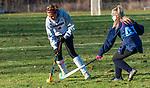 LITCHFIELD, CT-111220JS07—Wamogo's Abby Lutz (4) navigates the ball past Shepaug's Brianna Laskowski (41) during their field hockey game Wednesday at Wamogo High School. <br />  Jim Shannon Republican-American