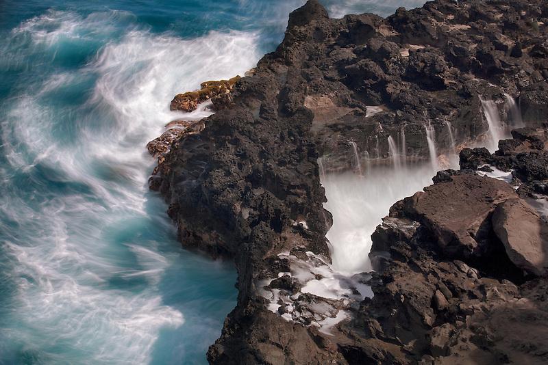 Rough surf off rocky Maui, Hawaii coastline.