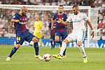 Real Madrid's Karim Benzema and FC Barcelona's Javier Mascherano during Supercup of Spain 2nd match at Santiago Bernabeu Stadium in Madrid, Spain August 16, 2017. (ALTERPHOTOS/Borja B.Hojas)