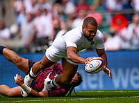 4th July 2021; Twickenham, London, England; International Rugby, Autumn Internationals, England versus United States of America; Ollie Lawrence of England runs in a try under pressure from Mikey Te'o of USA