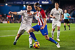 Daniel Carvajal Ramos of Real Madrid battles for the ball with Filipe Luis of Atletico de Madrid during their La Liga match between Atletico de Madrid and Real Madrid at the Vicente Calderón Stadium on 19 November 2016 in Madrid, Spain. Photo by Diego Gonzalez Souto / Power Sport Images